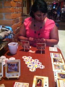 My wife Usha and I playing games at Snakes and Lattes in Toronto on a recent trip